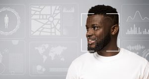 Smiling black man in white t-shirt looking to the side (right). Surrounded by images evoking personal info like maps